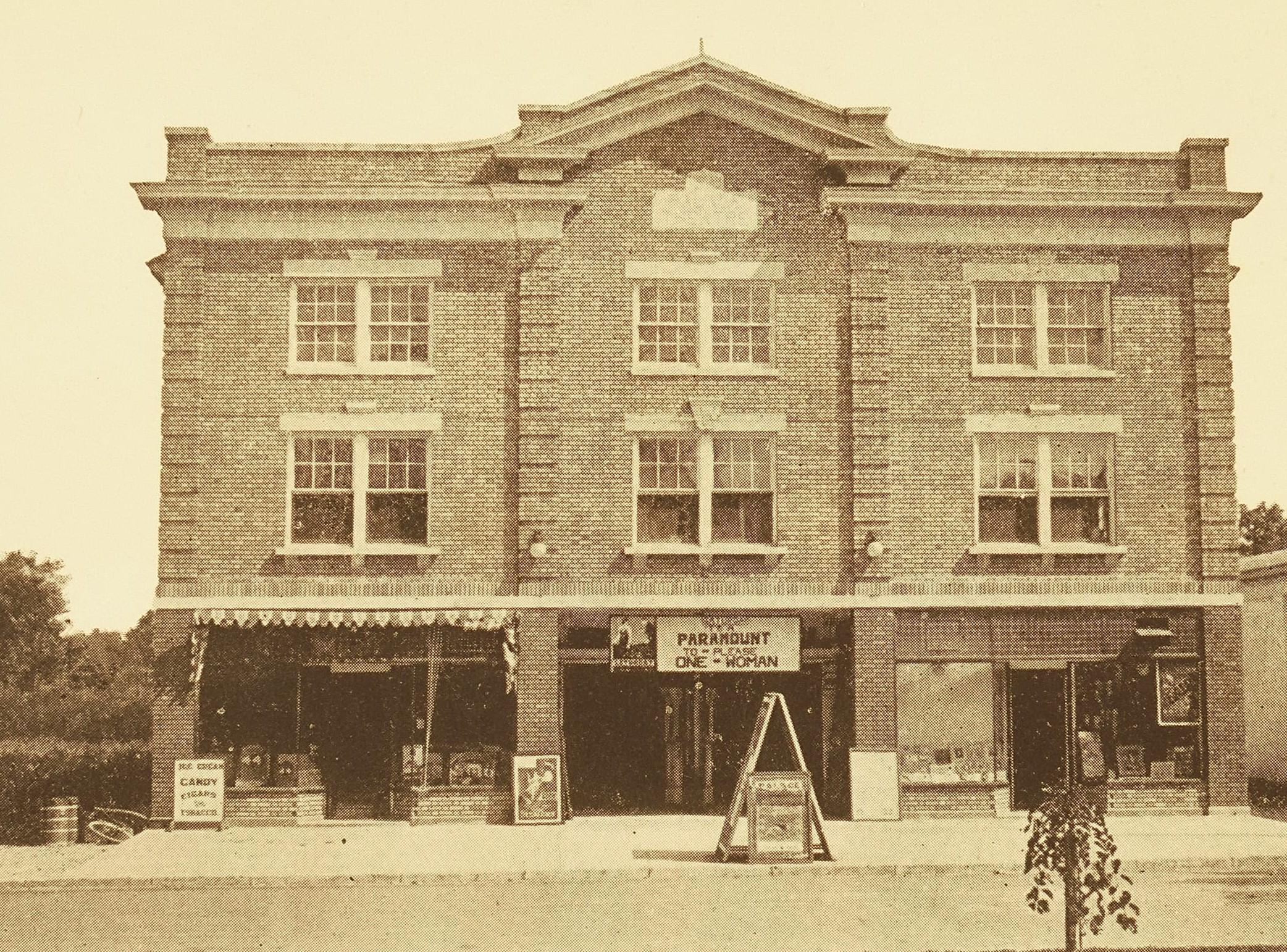 A vintage photograph of a brick facade building