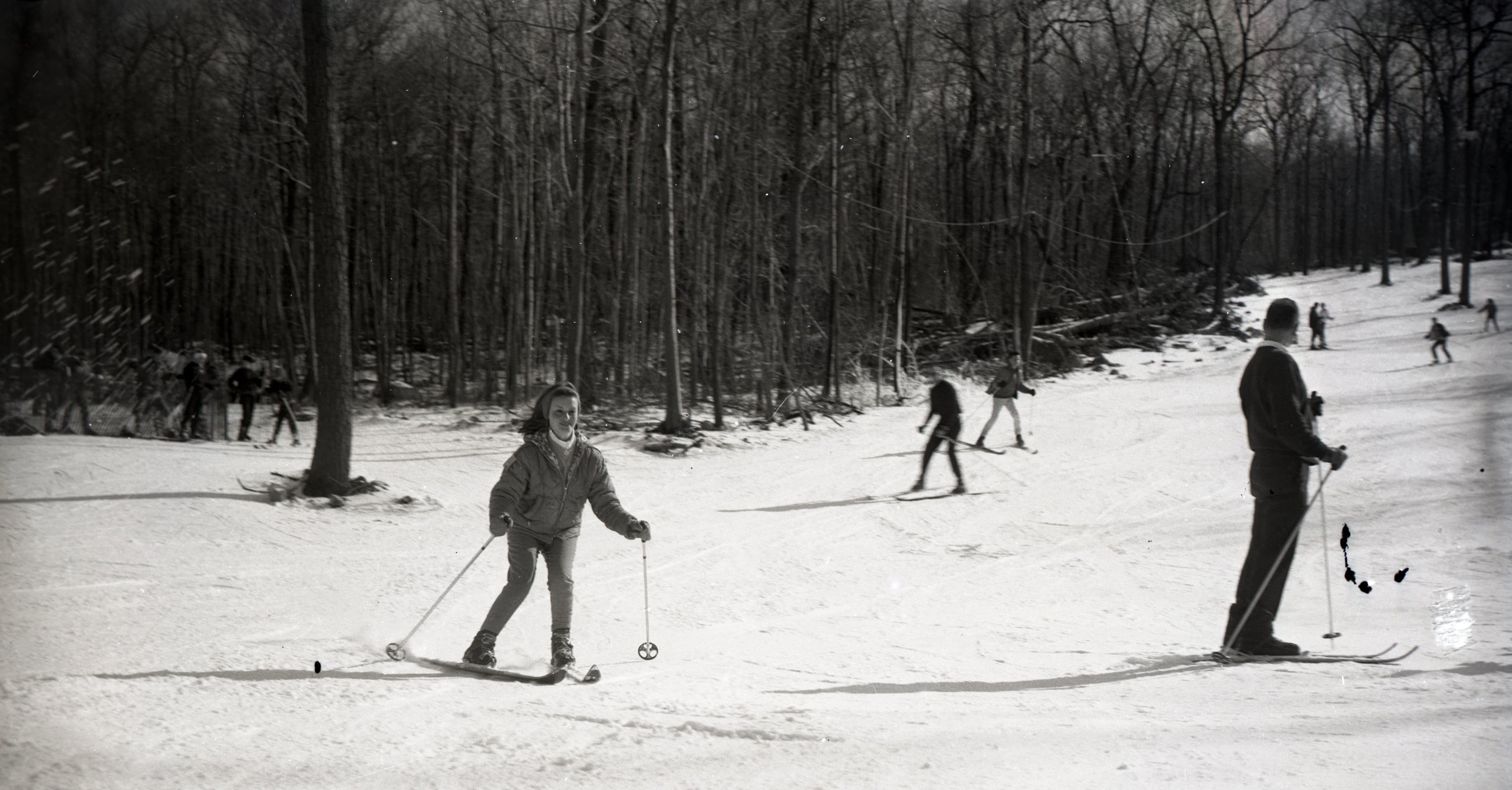 vintage photograph of a group of skiers on a slight hill
