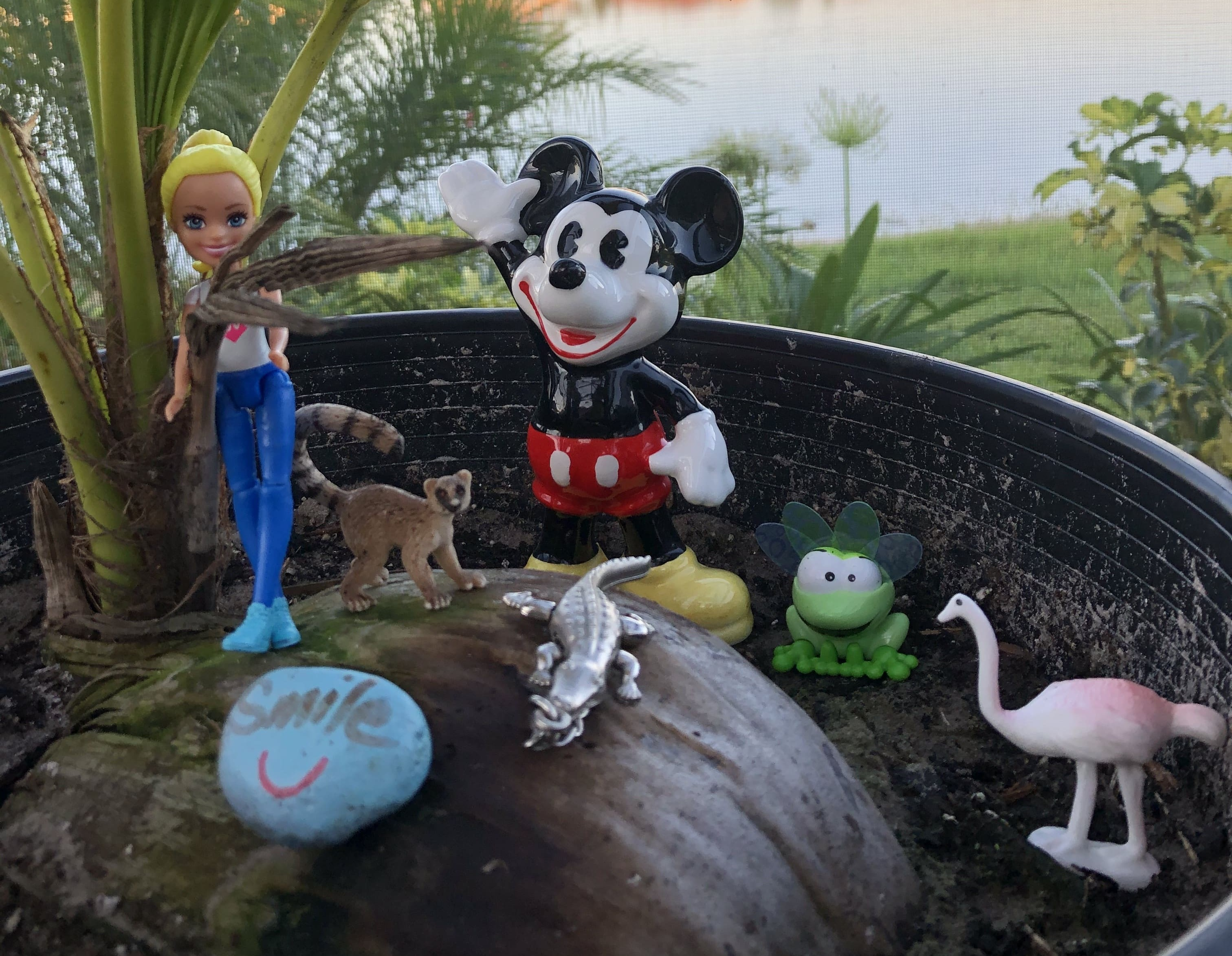 Collection of toys in a plant pot