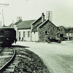 A trolley sits on the tracks in Landing across from Lackawanna Station building.