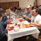 Guests sit at long tables, enjoying a spaghetti and meatball dinner to support Marine Sgt. Aaron Alonso at the Alonso Strong benefit held at American Legion Post 245, Saturday, April 12.