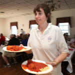 Karen Slusark serves spaghetti dinners to guests of the Alonso Strong benefit held at American Legion Post 245, Saturday, April 12.