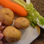 The simple ingredients used for lentil soup; diced ham, carrots, potatoes, celerey and lentils.