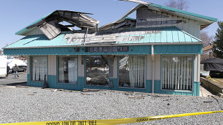 The showroom at MarineMax marina is severly damaged by an overnight fire, Wednesday, April 16.