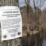 The NJ Department of Environmental Protection Division of Fish and Wildlife posted this sign on a tree at the edge of Riggs Pond on Russia Rd. in Oak Ridge but it did not stop some locals from enjoying opening day of trout season, even though no fish were caught by mid-morning.