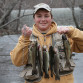 Jacob Mangeri from Pompton Plains proudly shows off the six trout he caught while fishing the Rockaway River off Berkshire Valley Road in Jefferson, Saturday, April 5.