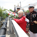 Former Jefferson Township mayor Fran Slayton, center, with help from Gunnery Sgt. Kevin Battavio, from Jefferson, left, and Marine First Sgt. Gerardo Ybarra from Picatinny Arsenal, right, toss a ceremonial wreath into Lake Hopatcong as part of the township's annual Memorial Day Celeberation, Monday, May 26.