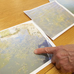 Photos showing weeds growing in River Styx were presented to the Lake Hopatcong Commission board at Monday's meeting.