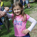 Lindsey Knapak, 7, from Mount Arlington happily shows off one of the fish she caught during the annual Knee Deep Club Junior Derby and Handicapped Outing held at the Mount Arlington Pond, Saturday.