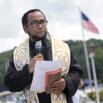 Father Vidal Gonzales, Jr., left, pastor at Saint Jude Parish in Hopatcong, leads the Blessing of the Fleet ceremony at Lakeland Marine Base in Nolan's Point.