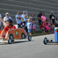 Maggie Hallowich, 9, left, and Chloe Esposito, 8, right, fly toward the finish line of the Arts' Karts Race.