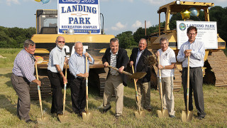 The Roxbury Township council surrounds mayor Jim Rilee, center, as he tosses a clump of grass during a groundbreaking ceremony at the Landing Road Recreation Complex.