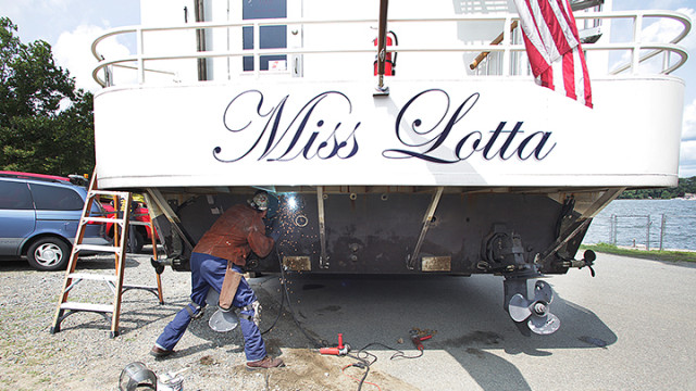 Gery Magura welds steel plates to the backend of Miss Lotta.