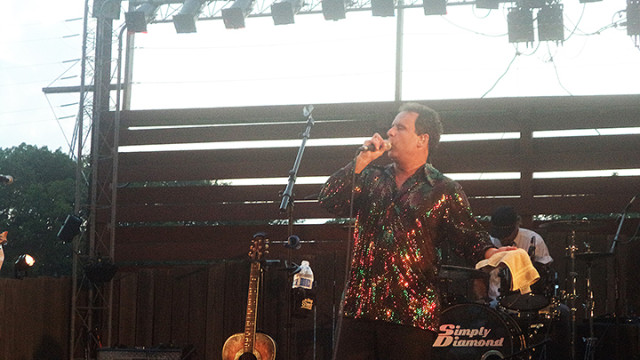 Brian La Blanc on stage at the Art Bonito Amphitheatre at Camp Jefferson singing Neil Diamond songs.