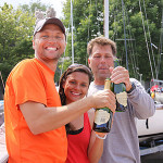 Brian, Lloyd and Catiana Kitchin celebrating their first-place finish at the 2014 Thisle National Championships on Lake Michigan.