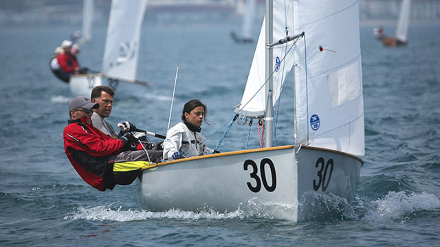 Brian, Lloyd and Catiana Kitchin competing in the 2014 Thisle National Championships on Lake Michigan.