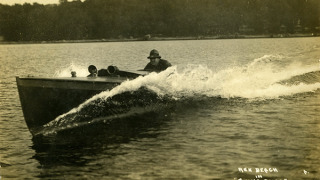 Rex Beach in his motorboat Going Some in 1912.
