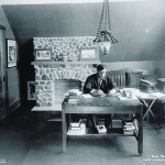 Rex Beach working on his novel The Iron Trail in 1912.