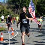 Joseph Hoke, 23, who served with Aaron Alonso in the 2nd BN 6th Marines from 2010-2013, carries the American flag throughout the entire race.