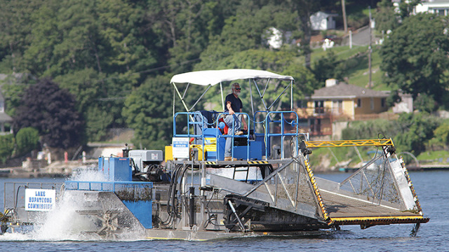Curtis Mulch at the helm of one of the weed harvesters on Lake Hopatcong. (2013 LHN file photo)