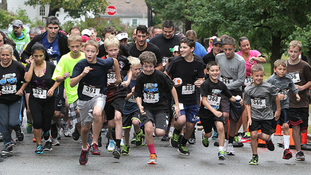 Racers sprint from the starting line at the third annual Joe Wargo Memorial 5K Run/Walk.