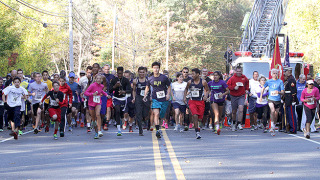 Competitors sprint from the starting line at the 16th annual Wrobo Run.