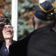 Tony Gross, American Legion Post 245 commander, salutes the flag during the playing of the National Anthem at Jefferson's Veterans Day observance.