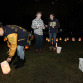 Nina Trasente, left, along with other members of the Interact Club from Roxbury HS, light candles at the King House at Drakesville.