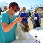 Terri Speizer from Hopatcong checks out her new saplings.