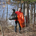 Nick Wunder, 19, from Wantage, carries out bags of garbage from thick underbrush at Hopatcong State Park.