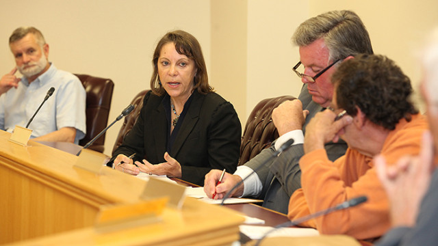 Kerry Kirk Pflugh, center, reports on the weed harvesting program at the Lake Hopatcong Commission meeting.
