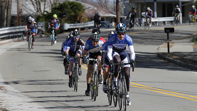 Cyclists participating in the 40-mile ride make their way down Mount Arlington Blvd.